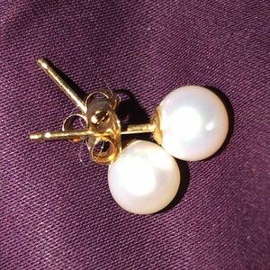 White pearl earrings with gold post